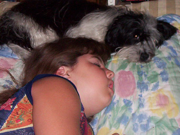Gabrielle sleeping with Havanese named Freedom
